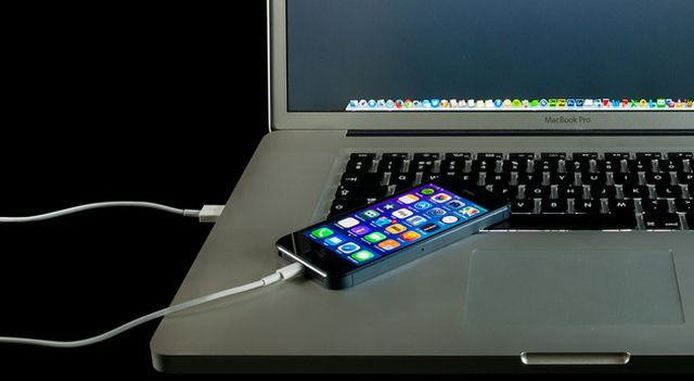 phone on laptop and charging